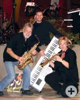 Die drei Musiker der Band Bella Musica mit Instrumenten