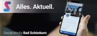 Hand mit Mobiltelefon und Text: Stage - Alles. Aktuell. Social Media Bad Schönborn.