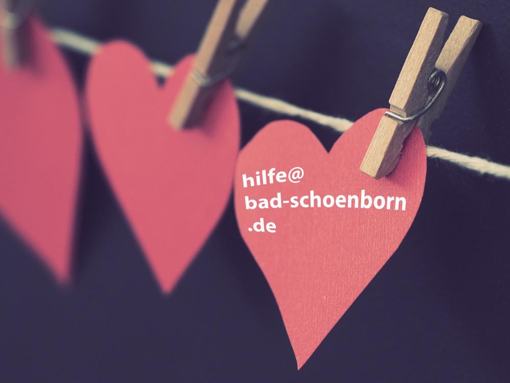 Herzen mit E-Mail-Adresse hilfe@bad-schoenborn.de